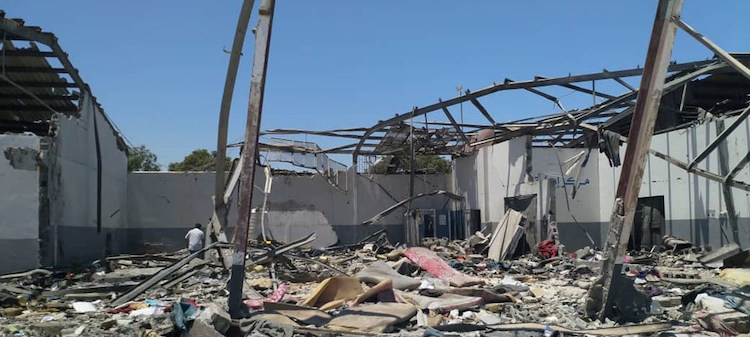 Photo: The aftermath of the devastating airstrike on the Tajoura Detention Centre, in the suburbs of the Libyan capital, Tripoli, on 2 July. Credit: UNSMIL/Georg Friedrich.