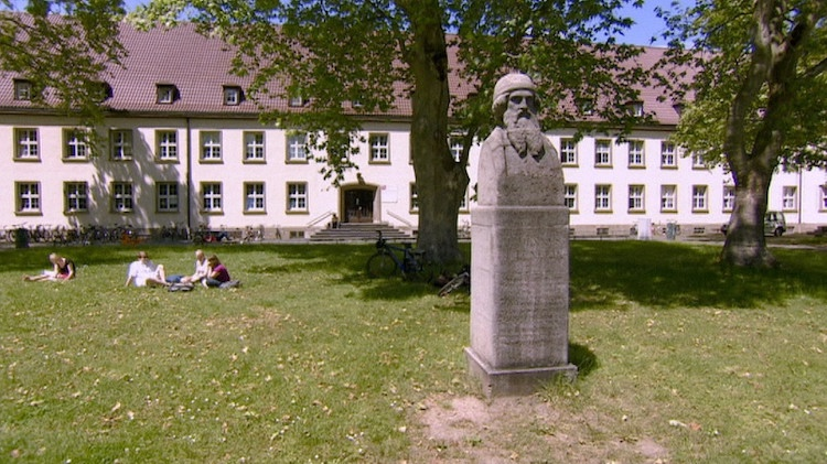 Photo: Internet has replaced the 'Gutenberg era', promising the horizontal system of information instead of the vertical. But that hope has been belied. Picture shows Gutenberg statue at the Johannes Gutenberg-University, Mainz. Credit: BR-Bavaria Radio.