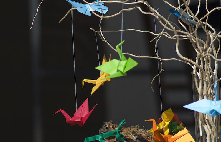 Image: These cranes made by origami are called orizuru and are one of the classic origami designs (Japanese paper folding technique). Legend has it that whoever manages to join 1,000 paper cranes with threads (senbazuru) will fulfill a wish. They became popular as a symbol of peace after World War II. Source: UNICEF