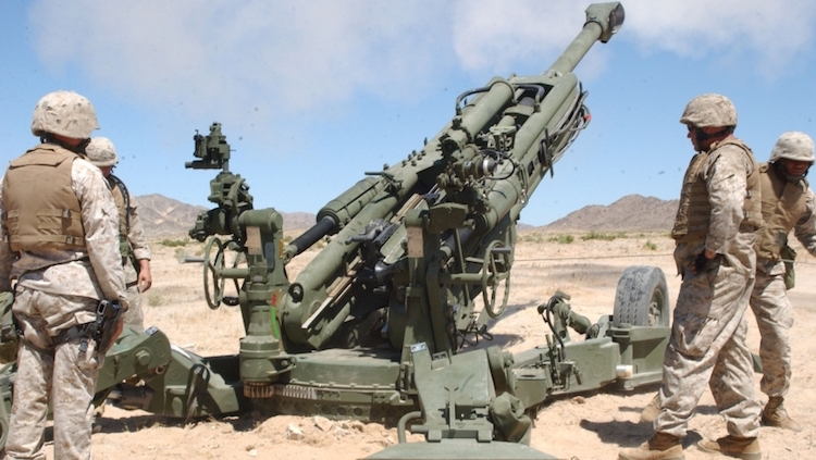 Photo: The Marines deploying in Syria reportedly have M777 howitzers, seen here with artillerymen at the Marine Corps Air Ground Combat Center. Credit: Wikipedia | U.S. Marines.